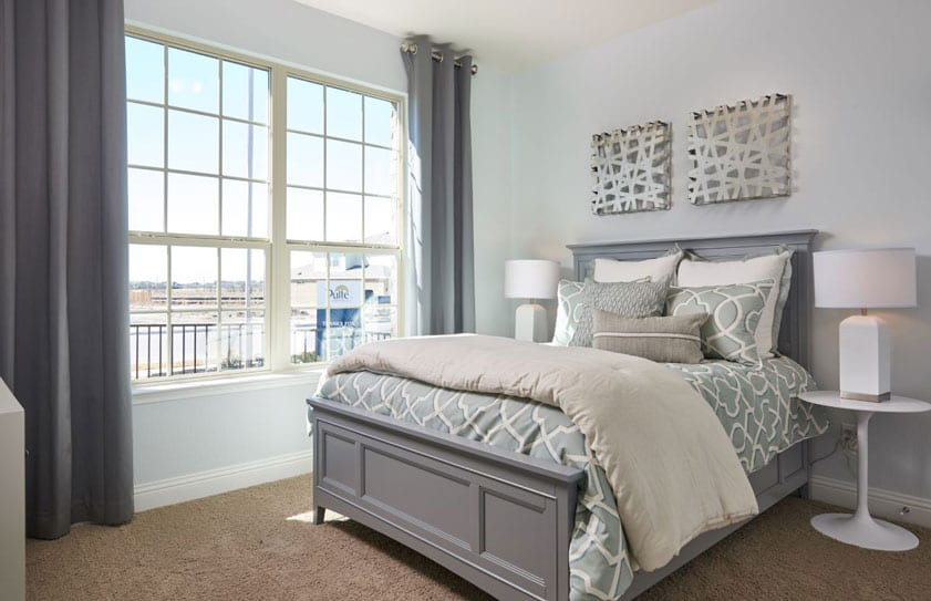 Gray and white bedroom with views of the Las Vegas strip seen out of the window
