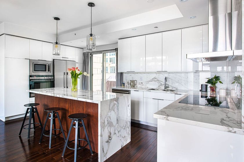 modern white kitchen with waterfall edge island in a Las Vegas home for sale