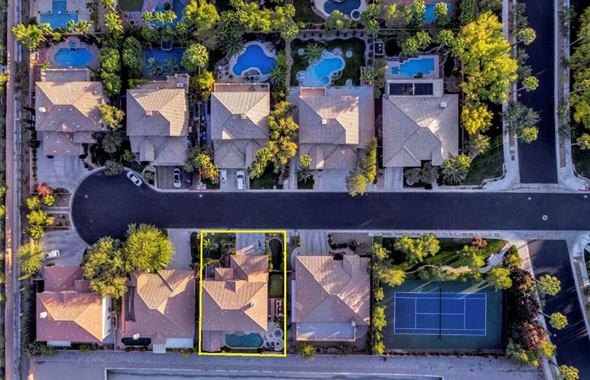 Drone photo of a property from directly above with yellow lines added to show property boundaries