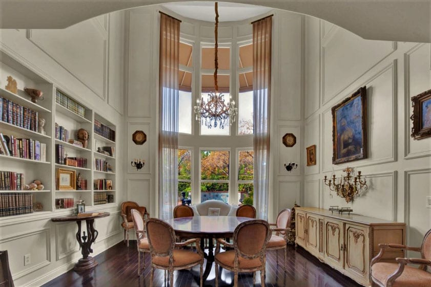 Formal dining room with high ceilings and chandelier