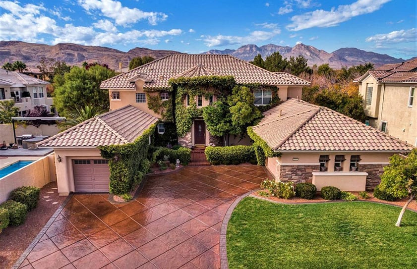 Large Las Vegas home seen from the air with views of the mountains in the background