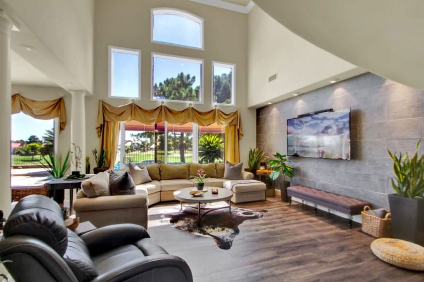 Grand living room with high ceilings and gold course views